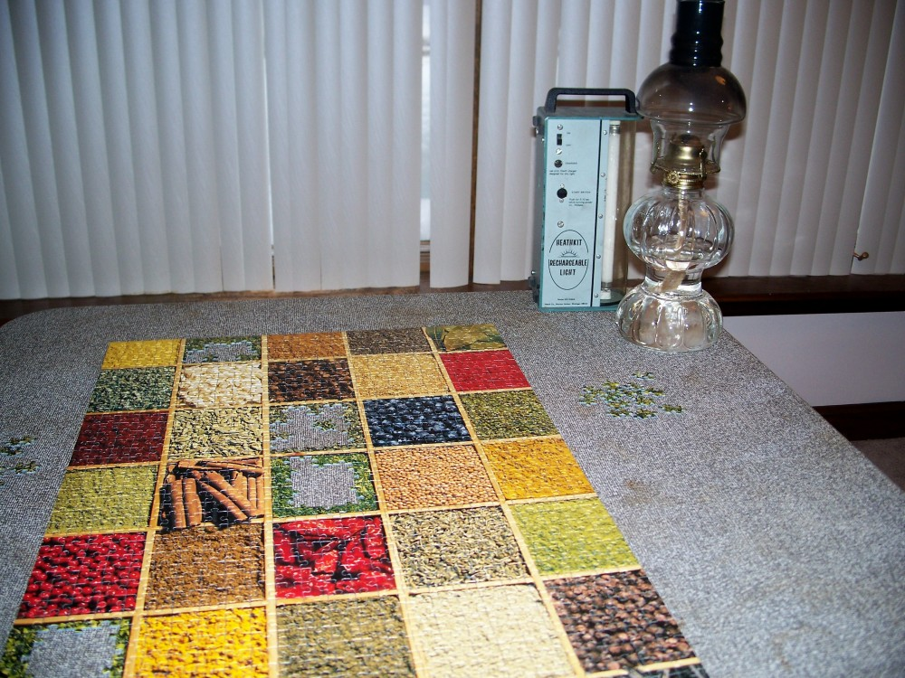 jigsaw puzzle and oil lamp