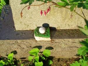 Stockbridge Cemetery - golf ball on astroturf