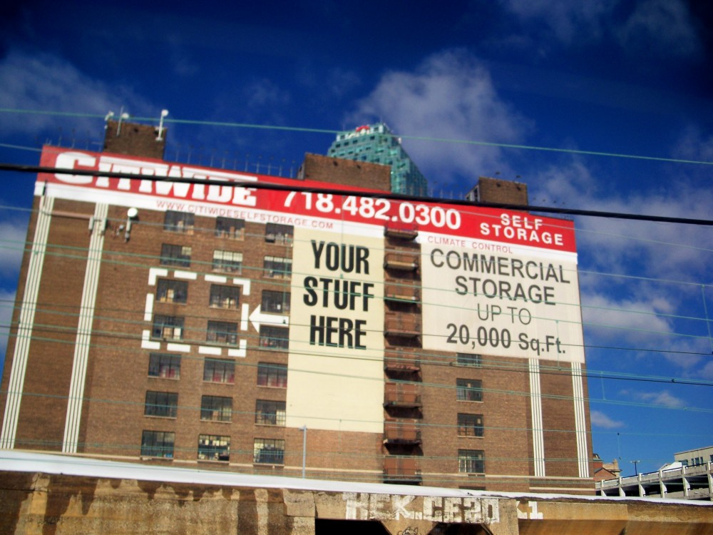 Your Stuff Here sign, from train, near NYC, 3 Feb 2011
